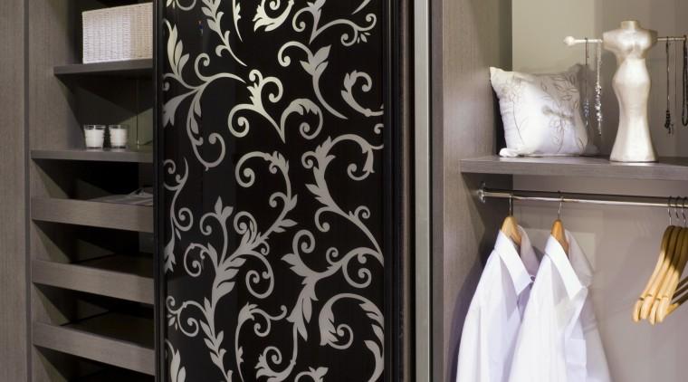 This grey linear patterned wardrobe from Innovative Interiors' closet, furniture, interior design, wardrobe, black, gray