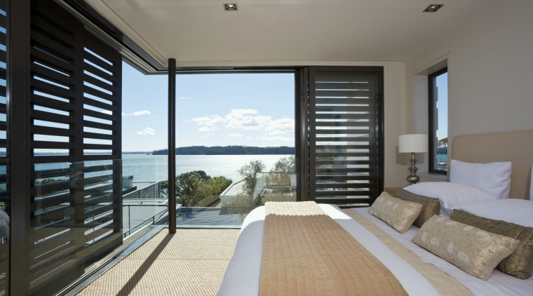 View of the master bedroom suite which features bedroom, condominium, daylighting, door, estate, house, interior design, penthouse apartment, property, real estate, room, window, window covering, wood, gray