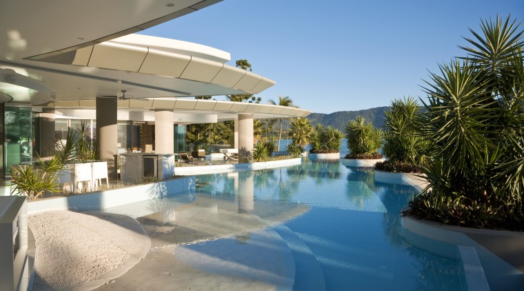 Exterior view of the outdoor area which features estate, home, house, leisure, property, real estate, resort, resort town, swimming pool, vacation, villa, water, teal
