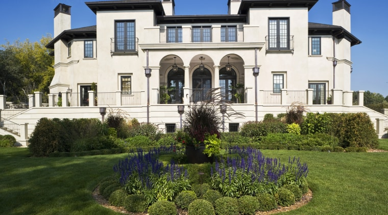 Exterior view of Renaissance styled home with stucco building, cottage, estate, facade, historic house, home, house, landscaping, lawn, mansion, property, real estate, residential area, villa, brown