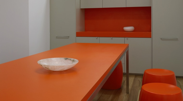 view of the lunch room which features table ceiling, chair, floor, flooring, furniture, interior design, light, light fixture, lighting, orange, product design, table, red, gray