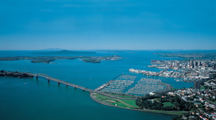 Image of the beautiful Auckland City. aerial photography, artificial island, bay, bird's eye view, city, coast, coastal and oceanic landforms, fixed link, inlet, sea, sky, water, water resources, teal