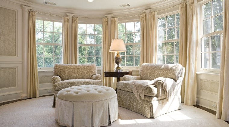 View of upholstered arm chairs, cushioned foot rest, ceiling, estate, floor, furniture, home, interior design, living room, property, real estate, room, wall, window, window treatment, gray
