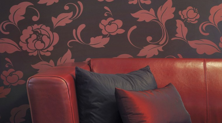 view of a living area which features Vision couch, interior design, pattern, red, wall, wallpaper, red, black