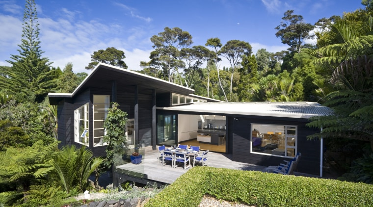 Exterior view of a 1970s felling Nz House architecture, cottage, elevation, estate, home, house, property, real estate, roof, villa