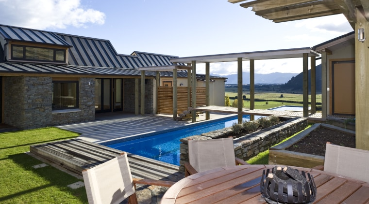 Exterior view of the outdoor area which features backyard, estate, home, house, leisure, property, real estate, swimming pool, villa