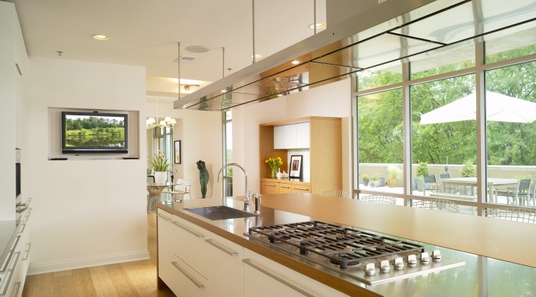 View of a kitchen which features a large countertop, estate, home, house, interior design, kitchen, property, real estate, window, orange