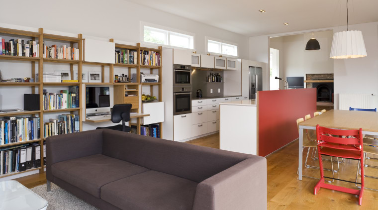View of open-plan kitchen area which features an bookcase, furniture, institution, interior design, library, living room, real estate, room, shelving, gray