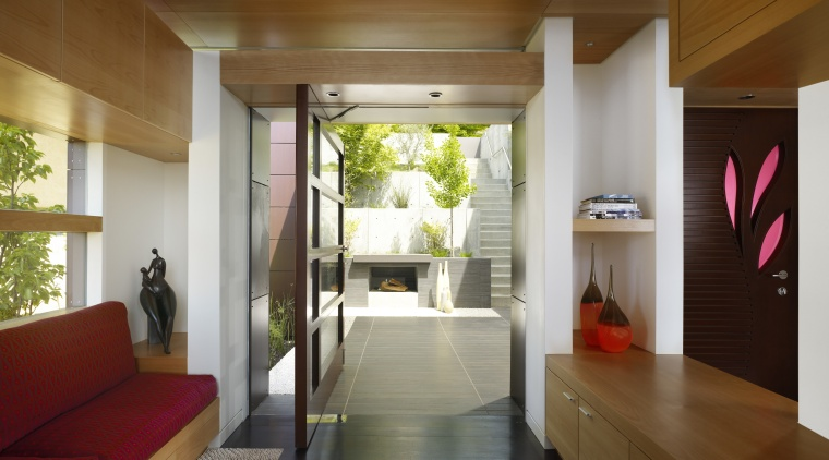 View of doorway leading to small enclosed courtyard. architecture, ceiling, home, house, interior design, property, real estate, brown, gray