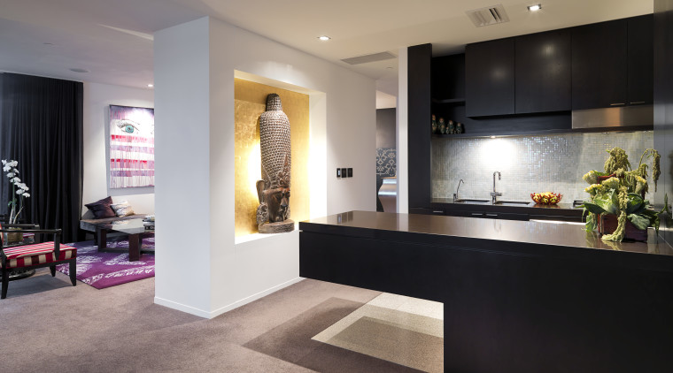 View of the kitchen where the island extends countertop, floor, flooring, interior design, kitchen, living room, lobby, room, gray, black