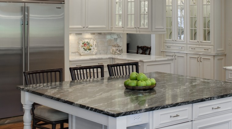 View of a kitchen which features a square cabinetry, countertop, cuisine classique, floor, home, interior design, kitchen, room, gray