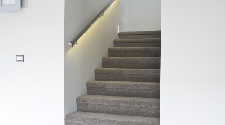 View of a carpeted stairway at the Harbourcity architecture, daylighting, floor, flooring, handrail, home, house, interior design, laminate flooring, product design, stairs, wood flooring, white, gray
