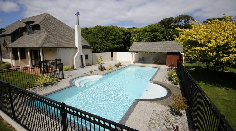View of a pool are with a resort cottage, estate, home, house, leisure, property, real estate, resort, swimming pool, villa, water, gray