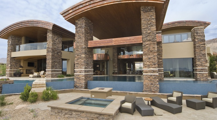Exterior view of this home built by Sun architecture, estate, home, house, property, real estate, residential area, villa, brown, gray