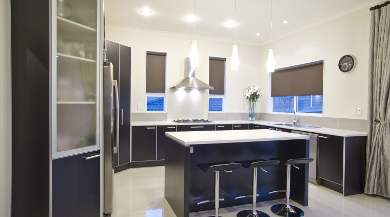 View of a kitchen which features dark stained cabinetry, countertop, interior design, kitchen, real estate, room, white
