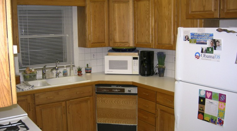 View of the kitchen prior to renovations. cabinetry, countertop, kitchen, room, brown