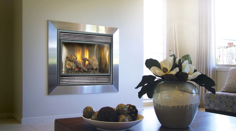 View of the GreenSmart gas fireplace with a fireplace, hearth, home, home appliance, interior design, living room, wood burning stove, white, gray