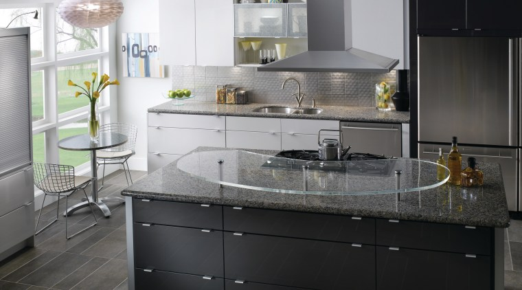 View of a contemporary kitchen which features countertops cabinetry, countertop, cuisine classique, interior design, kitchen, kitchen stove, sink, black, white