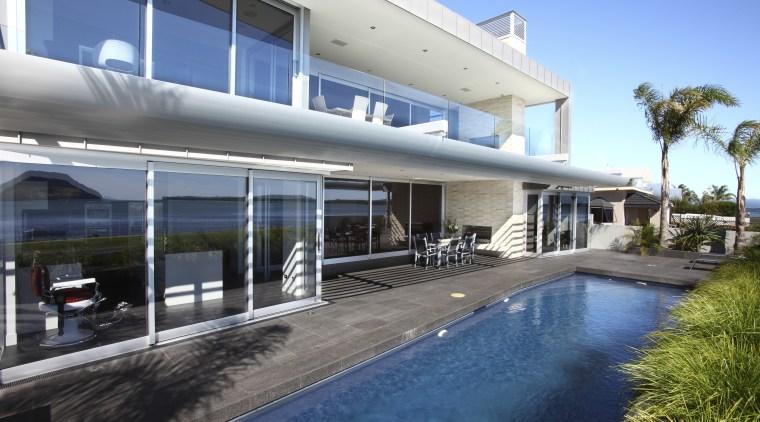 View of Pool resource pools estate, family car, house, property, real estate, resort, swimming pool, villa, window