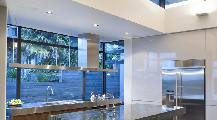 View of kitchen featuring american walnut base cabinets, architecture, ceiling, countertop, interior design, kitchen, real estate, table, white, gray
