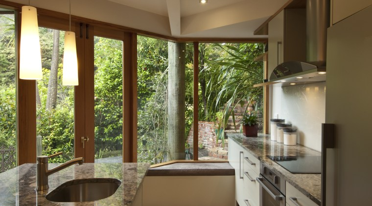 A new layout ensures views take priority.Mood lighting architecture, countertop, estate, home, house, interior design, real estate, window, brown