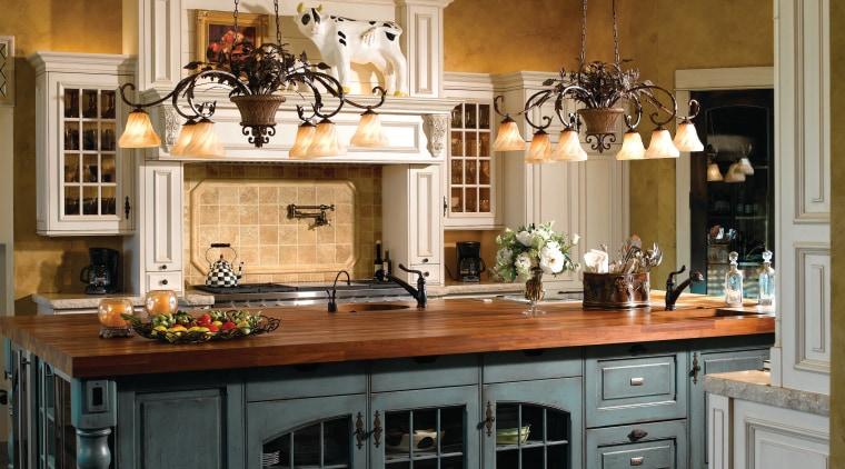 View of kitchen designed by Angela Otten from cabinetry, countertop, cuisine classique, flooring, hardwood, interior design, kitchen, room, wood flooring, brown, black