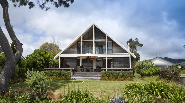 View of renovated beach house designed by architect cottage, estate, facade, farmhouse, grass, home, house, landscape, plant, plantation, property, real estate, residential area, sky, tree, villa, brown