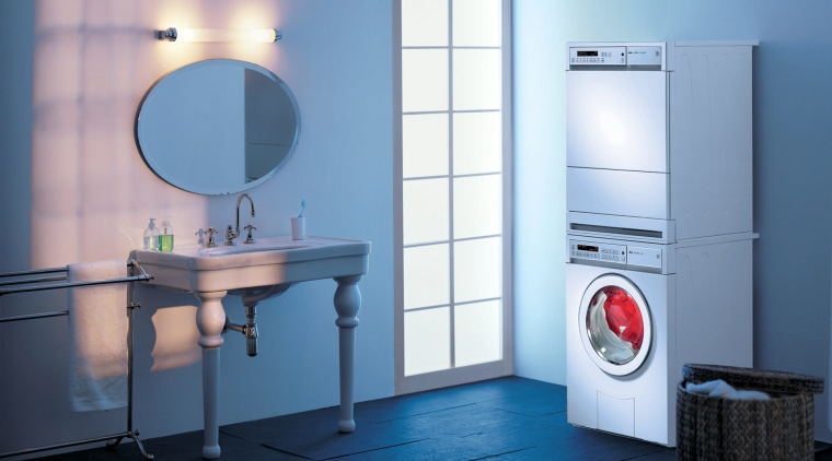 The company that pioneered home appliance technology in bathroom, bathroom accessory, bathroom cabinet, clothes dryer, home appliance, laundry room, major appliance, plumbing fixture, product, product design, purple, room, toilet, washing machine, teal, blue