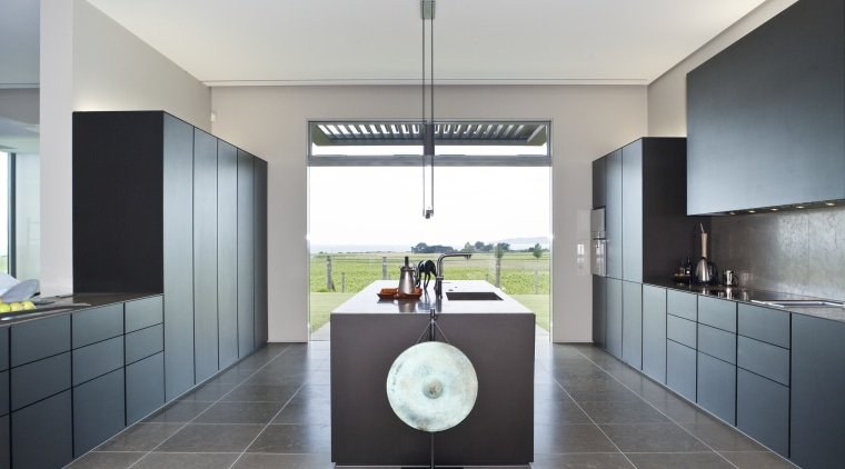 View of a contemporary kitchen which features island, architecture, countertop, interior design, kitchen, product design, real estate, room, gray, white
