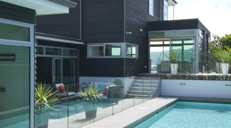 Poolside view of the contemporary home. architecture, estate, facade, home, house, leisure, leisure centre, property, real estate, swimming pool, water, teal, white