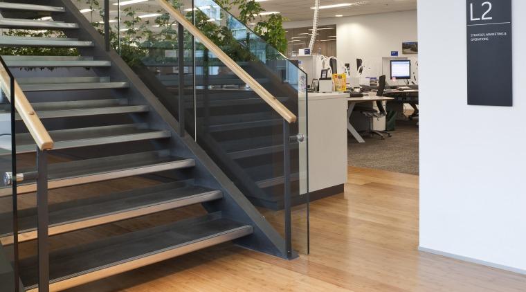 View of the staff room of the BNZ floor, flooring, handrail, hardwood, interior design, laminate flooring, stairs, wood, wood flooring, orange