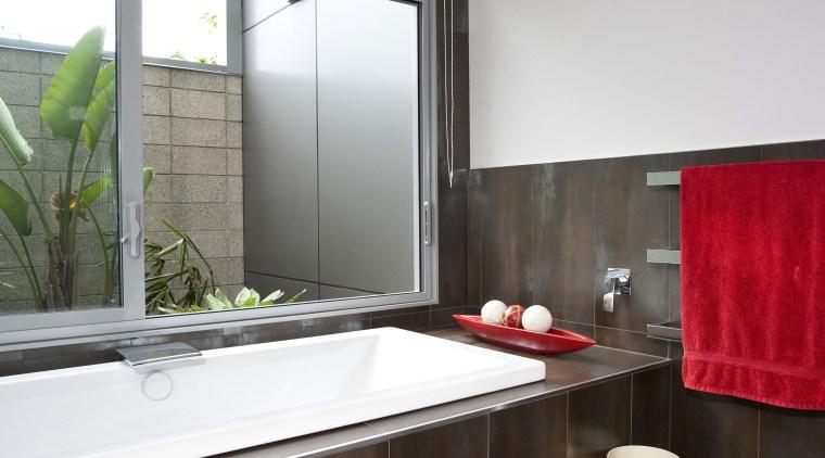 View of bathroom which features dark brown floor architecture, bathroom, countertop, interior design, real estate, room, window, gray, black