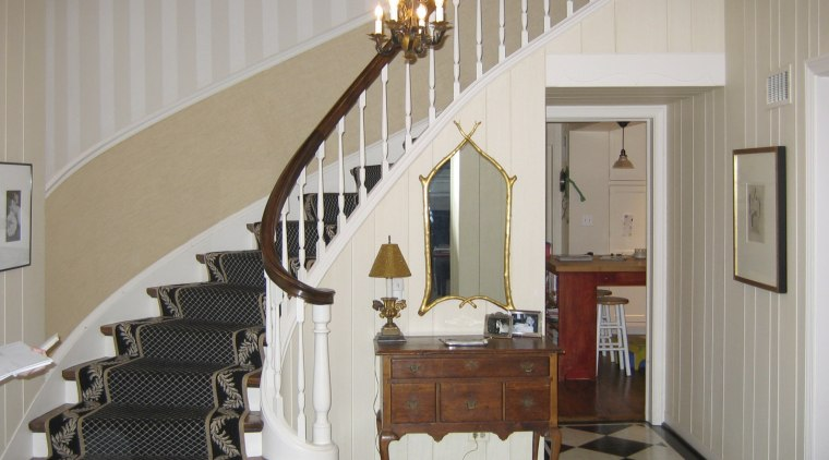 View of the stairway in this traditional house baluster, ceiling, floor, flooring, handrail, home, interior design, real estate, room, stairs, wall, gray