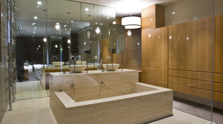 View of contemporary bathroom with mirror wall, white architecture, ceiling, floor, flooring, glass, interior design, lobby, brown, gray