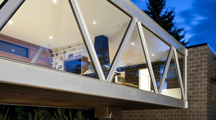 Exterior view of the glazed steel bridge. architecture, building, daylighting, facade, home, house, real estate, residential area, roof, sky, window, brown, blue