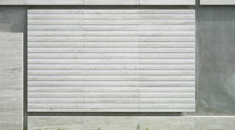 Close up view of this modern home's siding architecture, door, facade, siding, wall, window, gray, white