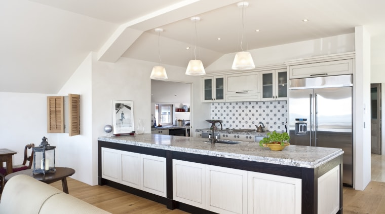 Traditional kitchen features stainless steel appliances & wooden countertop, cuisine classique, interior design, kitchen, real estate, room, white