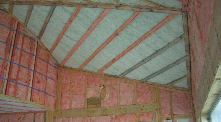 View of home insulation by Insultech Group. attic, beam, building insulation, ceiling, daylighting, roof, shed, structure, wall, wood, gray, brown