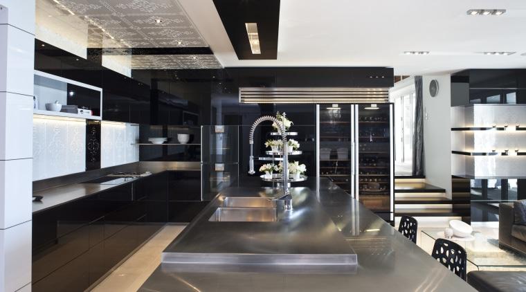 Close-up view of this kitchen island interior design, kitchen, white, black
