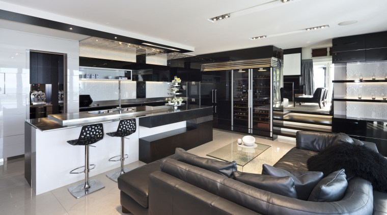 View of this living area situated by the interior design, kitchen, gray, black, white