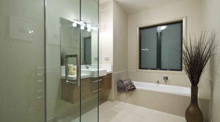 View of the bathroom of this Landmark Homes bathroom, floor, glass, interior design, property, real estate, room, gray