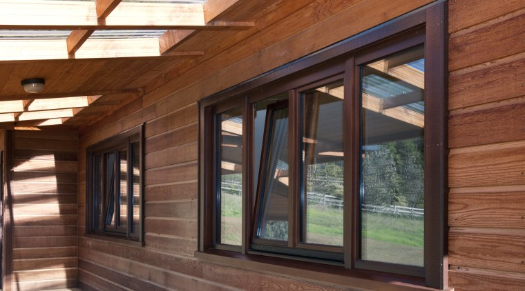 View of windows set into timber joinery by daylighting, home, house, real estate, roof, siding, window, wood, wood stain, red