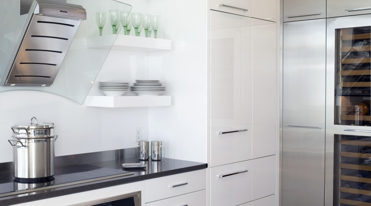 View of contemporary apartment kitchen which features timber cabinetry, countertop, cuisine classique, floor, home appliance, interior design, kitchen, kitchen appliance, kitchen stove, major appliance, refrigerator, room, gray, white