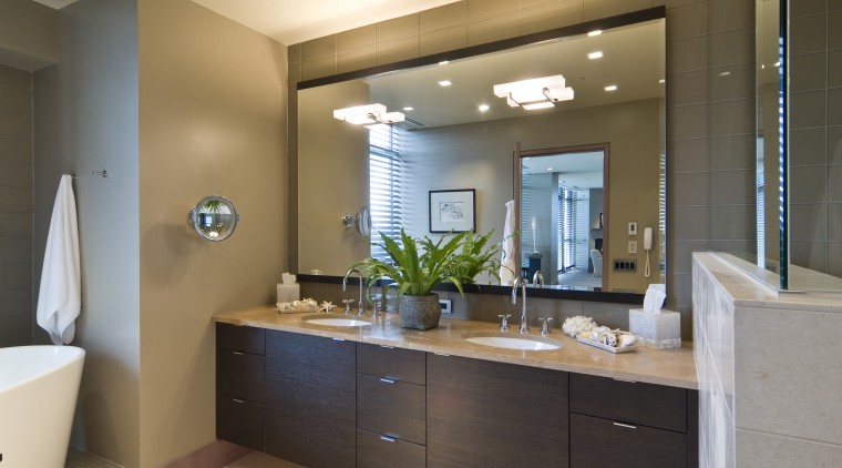 View of contemporary bedroom and bathroom with subdued bathroom, bathroom accessory, bathroom cabinet, cabinetry, countertop, home, interior design, room, sink, brown