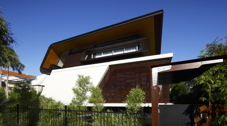 Exterior view of this contemporary home by Arkhefield architecture, facade, home, house, outdoor structure, real estate, residential area, roof, sky, blue, black