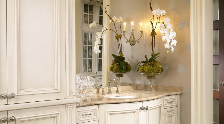 View of traditional bathroom bathroom accessory, cabinetry, chest of drawers, countertop, cuisine classique, floor, flooring, furniture, home, interior design, molding, room, window, white, brown