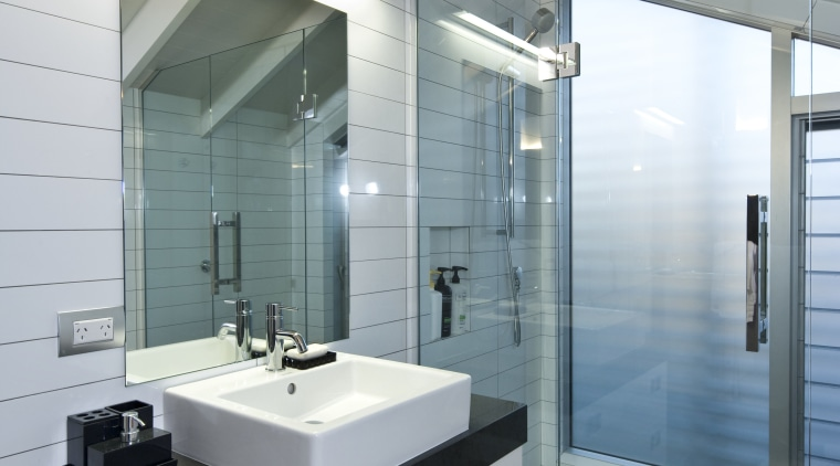 Bathroom with wooden flooring, white vanity with dark architecture, bathroom, floor, glass, interior design, room, sink, gray