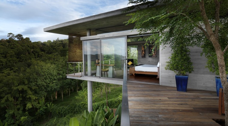 View of deck with bush landscape. architecture, backyard, cottage, home, house, outdoor structure, property, real estate, tree