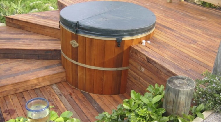 View of traditional style hot tub with deck backyard, wood, wood stain, yard, brown, orange