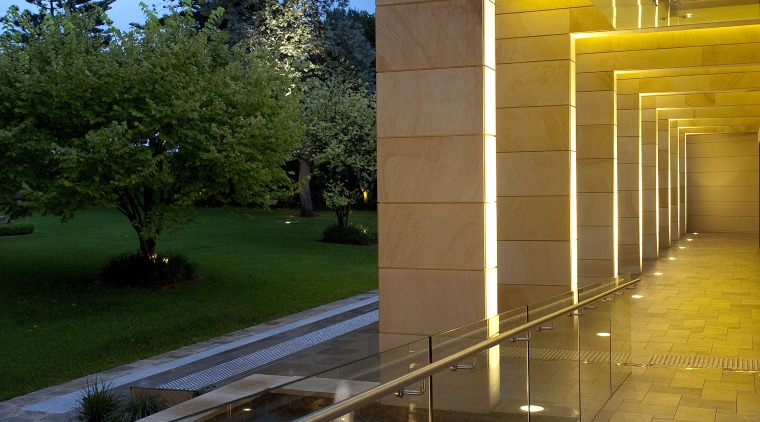 Exterior view of the sandstone hall architecture, evening, home, house, light, light fixture, lighting, real estate, reflection, residential area, sky, street light, sunlight, tree, water, yellow, brown